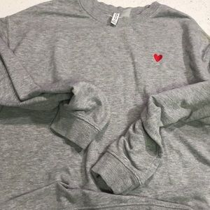 Divided grey long sleeve sweater with red heart